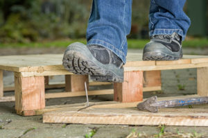 Worker almost stepping on nail