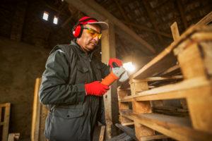 Worker remanufacturing a pallet
